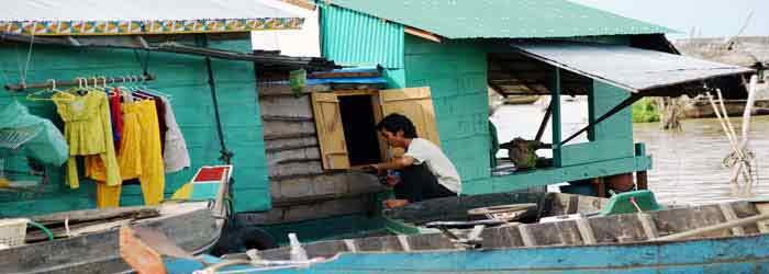 Man at Chong Khneas fixing window