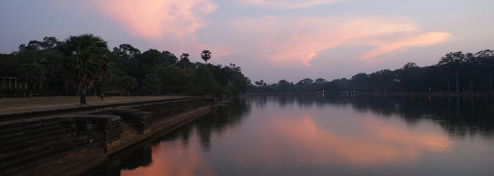 Sunset over Angkor Wat moat in Cambodia