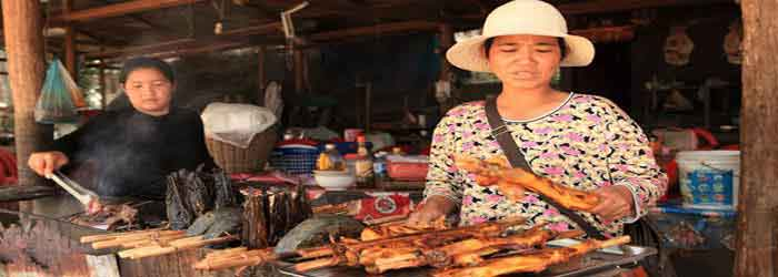 Cambodian woman cooking in a food stall