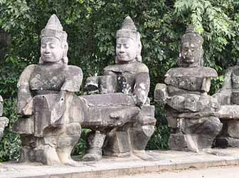 Sculptures in one of the entrances to Angkor Thom, Siem Reap.