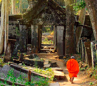Cambodia travel - angkor temple ruins with monk