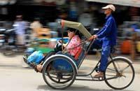 cyclo in phnom penh, cambodia