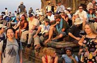 angkor wat without crowds - people at sunset